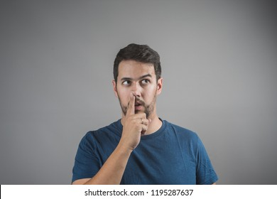 young man picking his nose with his finger