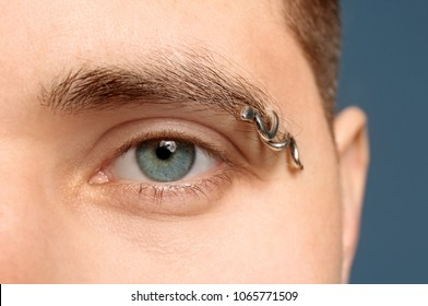 Young Man With Pierced Eyebrow Closeup