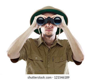 Young man in pith helmet looking through binoculars, isolated on white