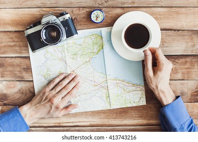 Young man planning vacation journey with map. Holidays and tourism concept