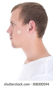 young man with plaster on his face isolated on white background