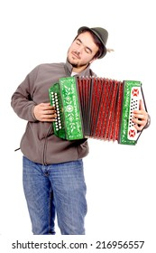 young man playing acordeon isolated