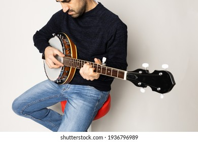 young man playing banjo on the white background