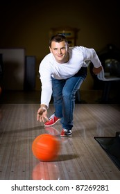 a young man playing bowling