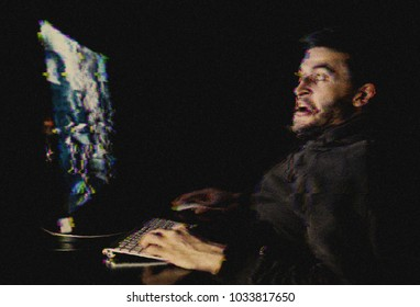 Young man playing computer games online. Digital glitch effect added