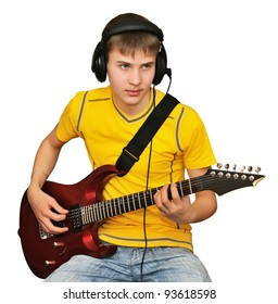 Young man playing electric guitar, looking to go public