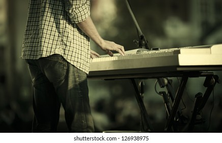 young man playing electronic keyboard, selective focus
