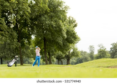 Young man playing golf on the golf course