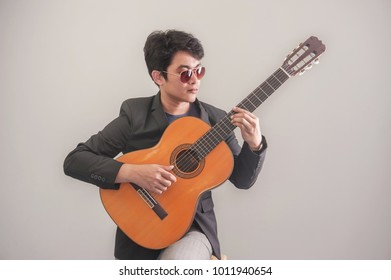 Young man playing guitar classic of relaxation music
