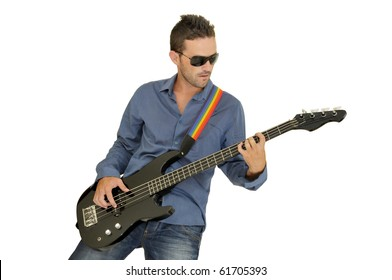 Young man playing guitar isolated in white