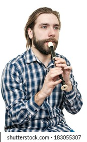 the young man playing on a recorder