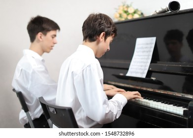 A young man playing piano on the stage
