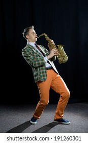 Young man playing the saxophone