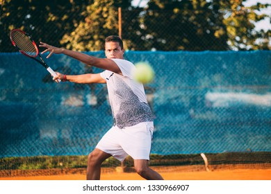 Young man playing tennis forehand stroke