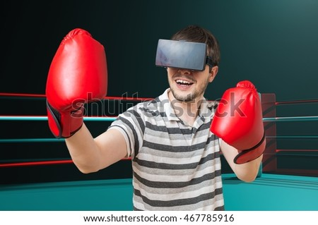 1c8e3893f1af Young man is playing video game and is boxing in ring with 3D virtual  reality headset
