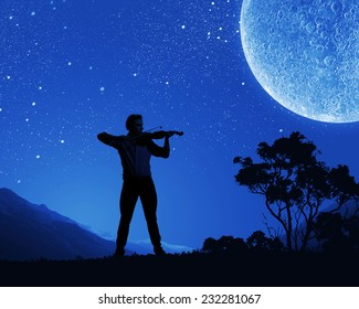 Young man playing violin at night under moon light