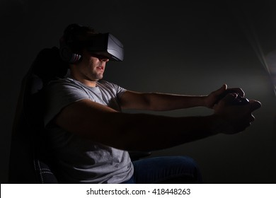 Young man playing a virtual reality video game