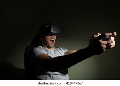 Young man playing a virtual reality game