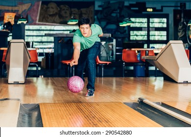 young man plays bowling