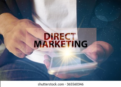 young man pointing at DIRECT MARKETING text on virtual screen. soft light with vintage filter. Internet concept.
