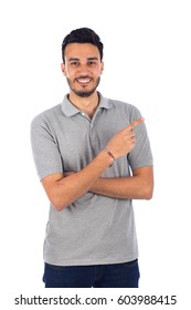 Young man pointing, isolated on white background