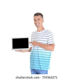 Young man pointing at laptop screen against white background