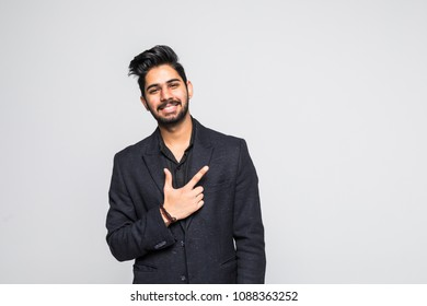 Young man pointing at something interesting on a white background