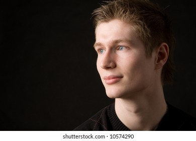 young man portrait on black background