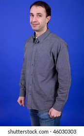an young man portrait over a blue background