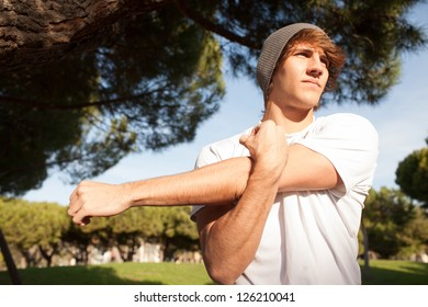 young man portrait stretching after jogging
