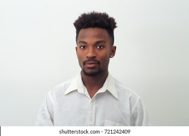 young man portrait in white shirt on white background