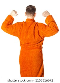Young man  posing in bathrobe after shower, back view