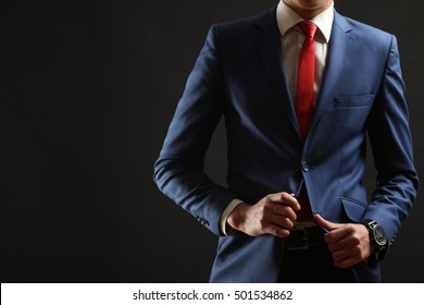 Young man posing in classic blue suit.