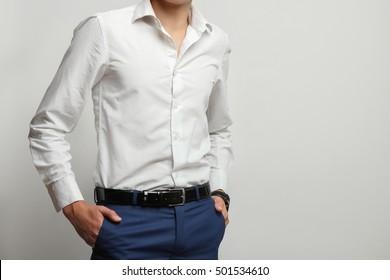The young man posing in the shirt.