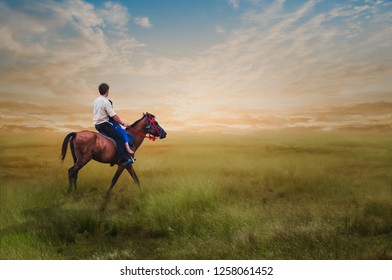 The young man practiced riding in the light of the morning sun.