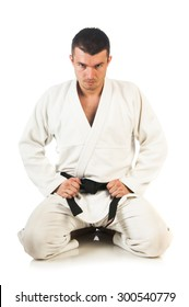 Young man practicing Brazilian jiu-jitsu (BJJ) isolated on white background