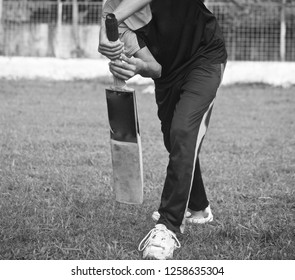 Young man practicing with a cricket bat unique photo