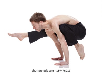 young man practicing yoga on white background