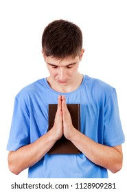 Young Man Praying with a Bible on the White Background