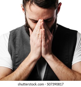 Young man praying over grey background