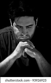 A young man prays