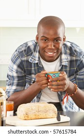Young Man Preparing Breakfast In Modern Kitchen