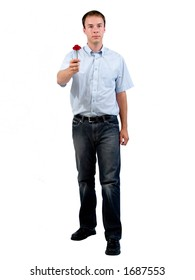 Young man presenting a flower.