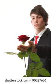Young man presenting a flower - red rose isolated white background