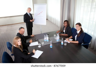 Young man presenting his ideas to colleagues