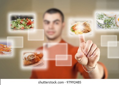Young man pressing a touchscreen button, with food selection
