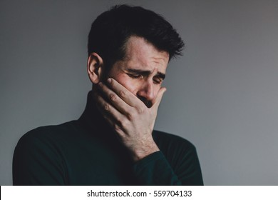 Young man with a problem crying