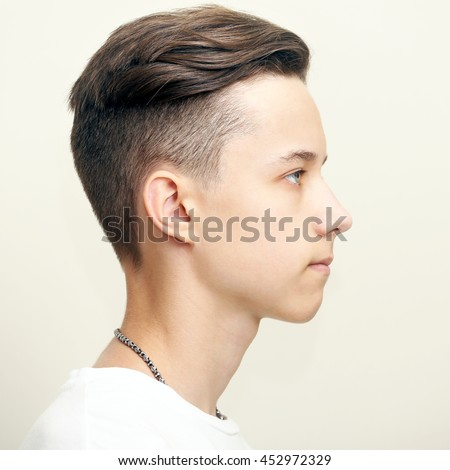 young man profile face over gray stock photo edit now 452972329