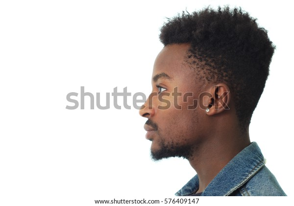 young man profile portrait twenty years old jeans jacket studio
