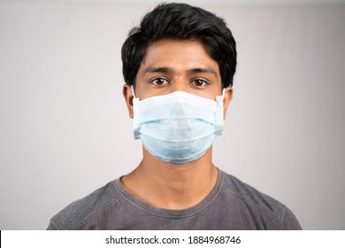 Young man properly covered nose and mouth with face mask - Awareness and safety concept to ware mask properly, to protect from coronavirus or covid-19 crisis on isolated background